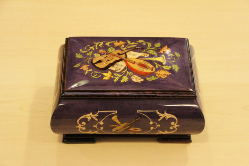 Italian inlaid music box adorned with musical instruments
